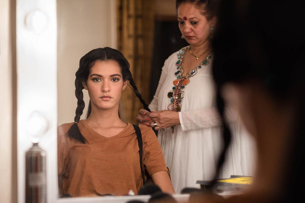 Models in the make-up room